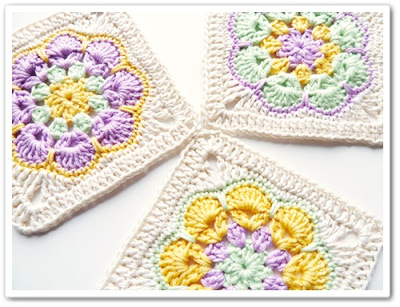 Barbara's African Flower Square from made in k-town.  Click the picture to link through to the tutorial.