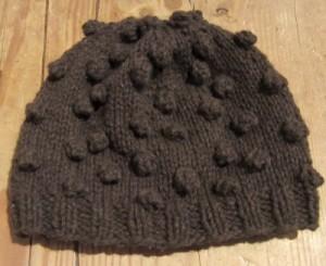 A bobble hat knit in mYak.