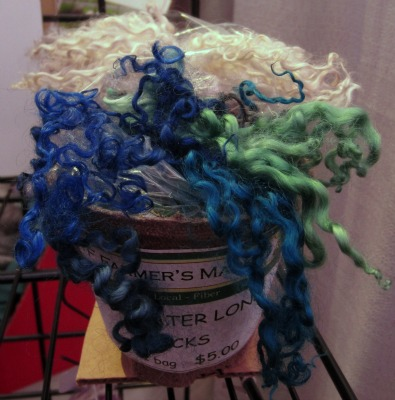 Dyed long locks on display in the Yellowfarm booth at Vogue Knitting Live.