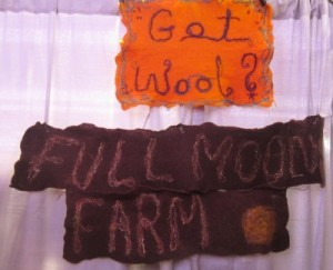 Felted signs in the Full Moon Farm's booth at Vogue Knitting Live in 2014.