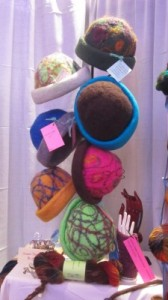 Felted hats at the Full Moon Farm booth at Vogue Knitting Live 2014.