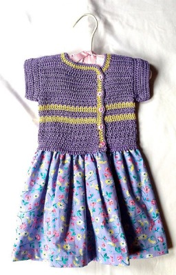 A dress combining a sewn cotton skirt with a crocheted, mercerized cotton top. (Size 6-12 months.)
