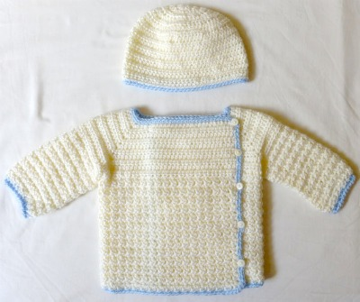 A crocheted hat and sweater set. (Size 3-9 months.)