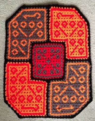 "In this double filet design, Barbara used elements of Central Asian carpet design in a shape known as ""elephant's foot."""