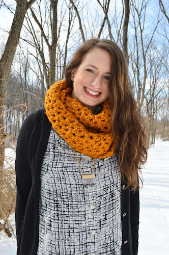 Anna Lisa Brown wearing a crocheted infinity scarf by Sew What Scarves on Etsy.