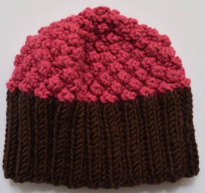Cupcake Hat, free knitting pattern in newborn, infant, toddler sizes by Marie Segares/Underground Crafter.