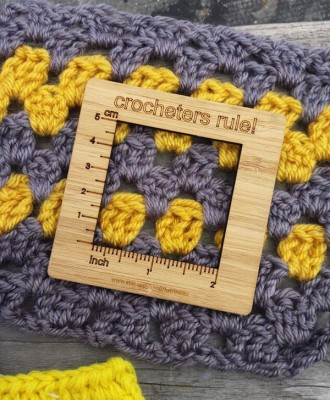 A crochet gauge ruler designed by katrinkles.