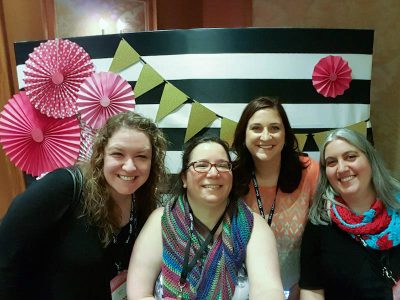 From left to right, Tamara from Moogly, Jessie from Jessie At Home, Carrie from Red Heart, and me at the Chinet booth at Snap! Photo via Jessie At Home.