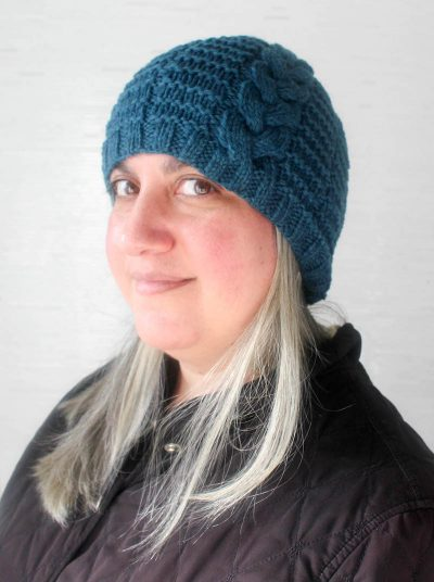 Free knitting pattern: Braided Beanie in Imperial Yarn Erin by Underground Crafter | A single, braided cable adds visual appeal to this stretchy, unisex beanie. Wear the cable at the center or to the side for different looks.
