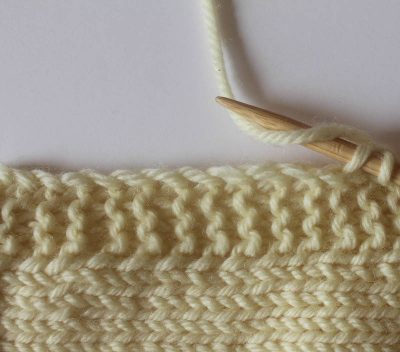 Knitting tutorial: How to pick up stitches by Underground Crafter | Whether you're adding a neckline to a sweater or a border to a blanket, here are two ways to pick up knitting stitches.