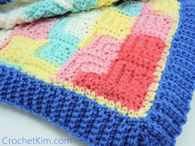 Patchwork Baby Blanket, free crochet pattern by Kim Guzman | 12 free crochet patterns for baby blankets, roundup curated by Crochet Pattern Bonanza for Underground Crafter. Crocheted baby blankets are perfect for keeping your little ones super cozy in the cold winter weather. They are not only great for the crib, but they also make for excellent covers in the stroller, or in the car. And to make them super cozy, you can always line them with a cotton or fleece material.