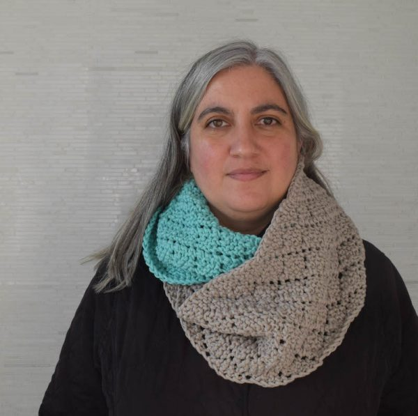 Free knitting pattern: Two-Toned Diamonds Infinity Scarf in Bernat Maker Home Dec yarn by Underground Crafter | Traveling eyelets form a diamond pattern in this cozy, color blocked infinity scarf. This unisex project works up quickly with bulky yarn.