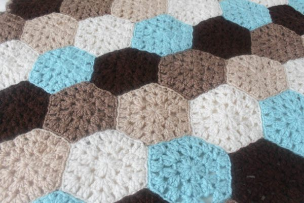 Hexagon Honeycomb Stroller Blanket, free crochet pattern in Red Heart Super Saver by Underground Crafter | This stroller blanket is made with portable hexagon motifs. Use 5 planned colors, or make it scrappy! Join the motifs and then add a border to bring it all together.
