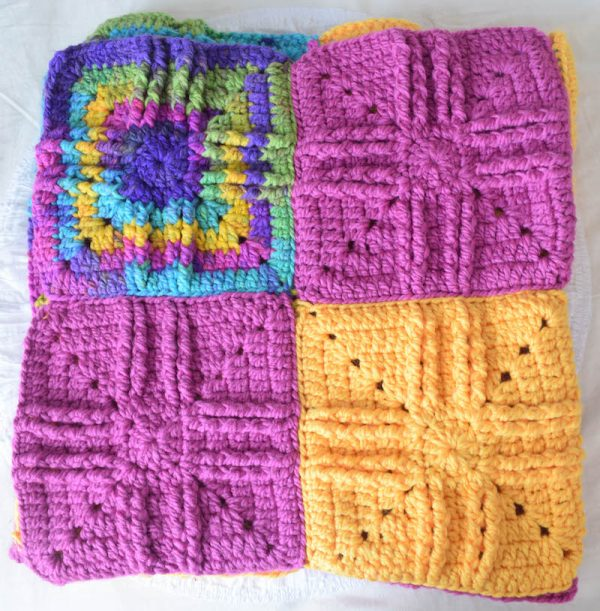 Sweet Treat Baby Blanket, free crochet pattern in Darice All Things You Bulky yarn by Underground Crafter   Textured granny squares and bulky yarn combine to create a cuddly blanket that doubles as a baby floor mat.