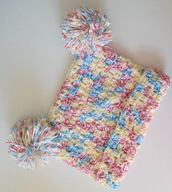 Free crochet pattern: C2C Pom Pom Hat in Bernat Softee Baby Colors by Underground Crafter | This simple, corner-to-corner (C2C) crochet hat pattern can be customized to fit any size and you don't need to worry about gauge.