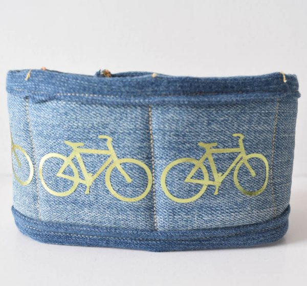 Semi-Quilted Upcycled Denim Bike Pant Leg Cuff, sewing tutorial by Underground Crafter | Wearing a bike cuff is a great way to keep your pant leg out of your bike's chain so you can avoid damaging your clothes or having an accident. This simple, lightly quilted project is easy enough for a sewing or quilting beginner. This project features foil iron-on for decoration, iron-on fasteners, and binding made from the back piece. Instructions are provided for customizing the size.