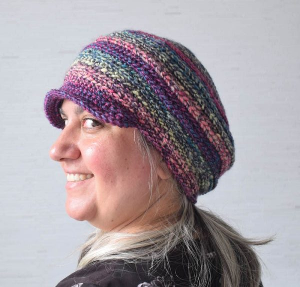 Free crochet pattern: Cobblestone Cap in Premier Yarns Aurora yarn by Underground Crafter | This brimmed, unisex hat uses self-striping yarn to create easy color changes and alternating hook placement to create interesting texture. It's the first pattern in the 2017 Holiday Stashdown Crochet Along.
