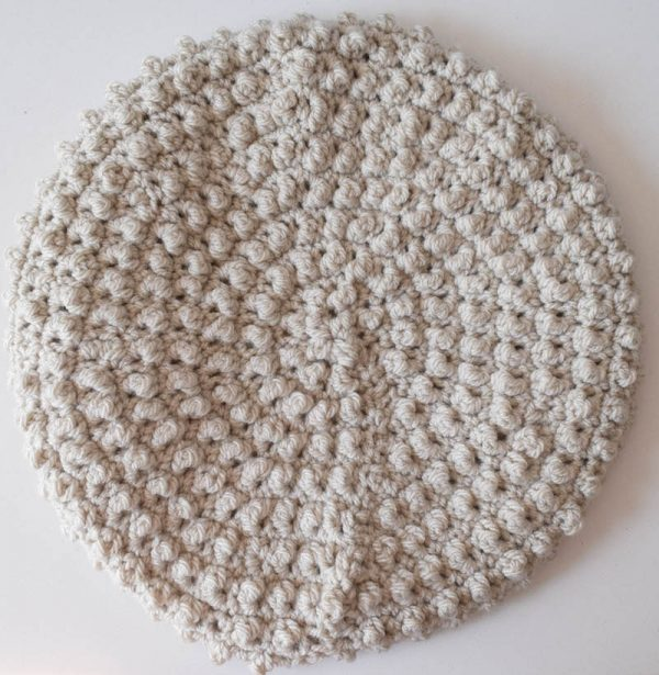 Free crochet pattern: Mock Bobbles Beret in Sprightly Acrylic Worsted yarn by Underground Crafter | This textured beret is made with a combination of tall and short crochet stitches. Available in infant, child, and adult sizes.