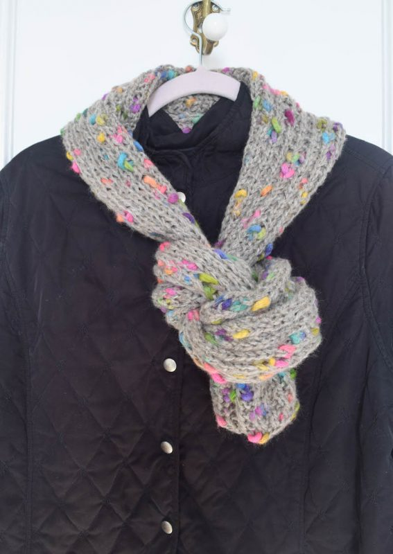 Free knitting pattern: Fire Beads Scarf in Yarnspirations Patons Peak yarn by Underground Crafter | A simple stitch and a textured yarn combine to add pops of color to a cozy accessory.