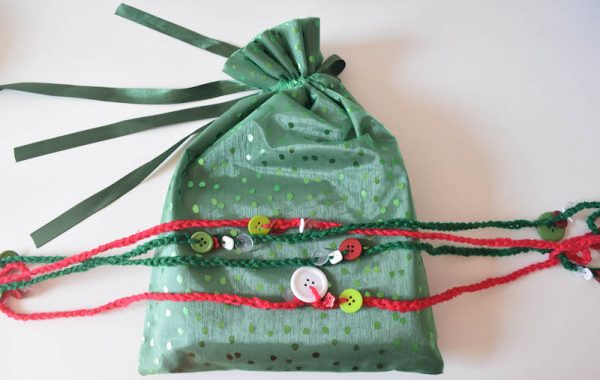 Simple Yarn Decorations by Underground Crafter The DIY Felted Balls Ornaments and the Crochet Button Garland are two simple, beginner-friendly projects that add a bit of handmade cheer to your holiday decorations.