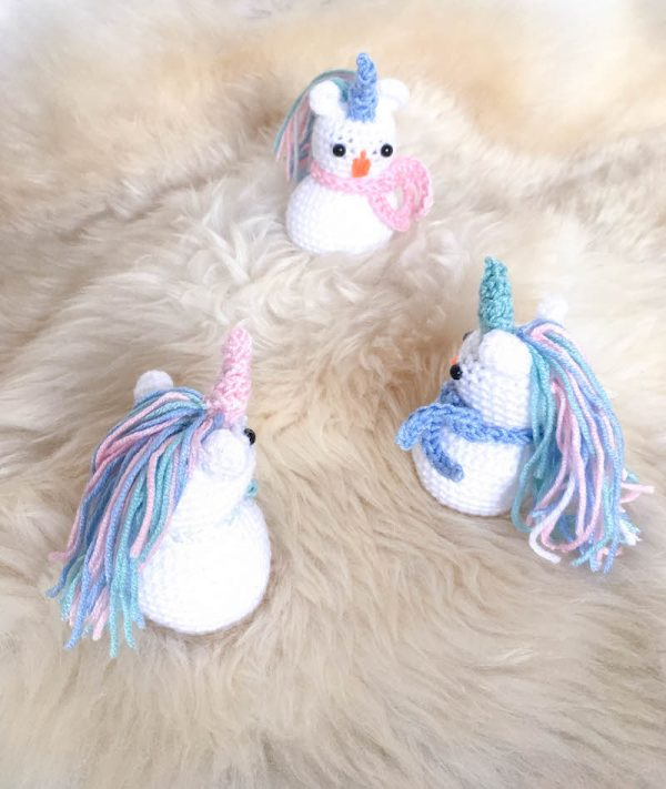 Free crochet pattern: Snowicorn amigurumi by DoraDoes for Underground Crafter | This adorable critter is a mashup of a snowman and a unicorn.
