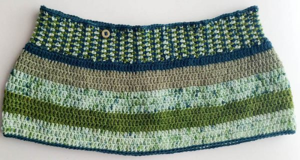 Free crochet pattern: Perpendicular Stripes Cowl in Lorna's Laces Shepherd Sock yarn by Underground Crafter   Simple stitches highlight stunning yarn colors in this feminine, buttoned cowl. This is a great pattern for using up sock yarn scraps!