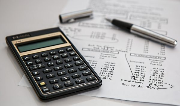 Calculator and pen with receipts | Is Selling Your Handmade Items a Hobby or a Business? Guest Post by The Yarny Bookkeeper for Underground Crafter