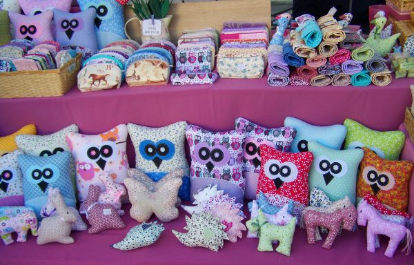 Craft fair table display with softies | Is Selling Your Handmade Items a Hobby or a Business? Guest Post by The Yarny Bookkeeper for Underground Crafter