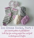 Striped, crocheted socks with yarn on white surface | Free crochet pattern: Ice Cream Socks, Part 2 by ACCROchet (with tips for making perfect toes and feet) on Underground Crafter