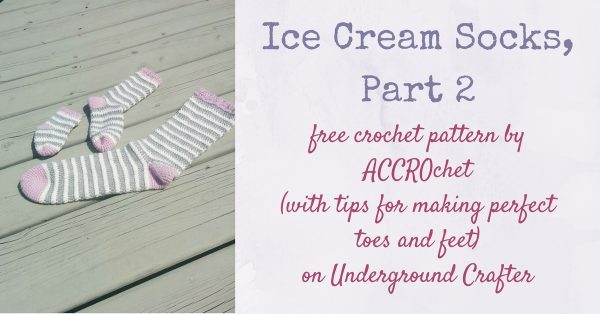 Striped, crocheted socks on wood surface | Free crochet pattern: Ice Cream Socks, Part 2 by ACCROchet (with tips for making perfect toes and feet) on Underground Crafter