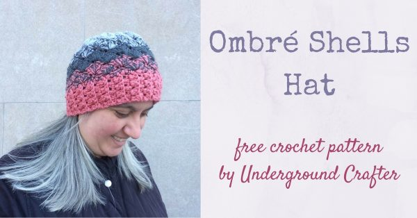 Woman with grey hair and black coat wearing crocheted ombré hat in pink and grays | Free crochet pattern: Ombré Shells Hat in Willow & Lark Ramble by Underground CrafterWoman with grey hair and black coat wearing crocheted ombré hat in pink and grays |