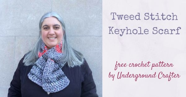Smiling woman wearing colorful crochet scarf and black jacket | Free crochet pattern: Tweed Stitch Keyhole Scarf in Cascade Anthem Chords by Underground Crafter