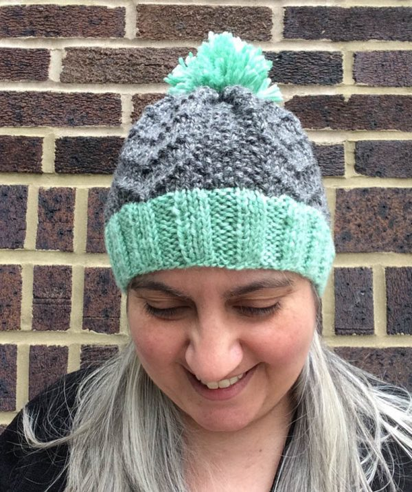 Free knitting pattern: Bird Tracks Beanie in Lion Brand Heartland in 4 sizes by Underground Crafter