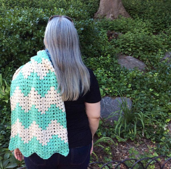 Free crochet pattern: Granny Chevron Wrap in Lion Brand Heartland by Underground Crafter - stripes worn over shoulder