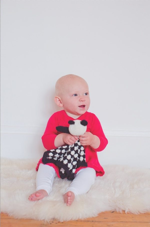 Granny Squares Weekend by Emma Varnam book review with pattern excerpt via Underground Crafter - Panda Cushion (lovey) image with child