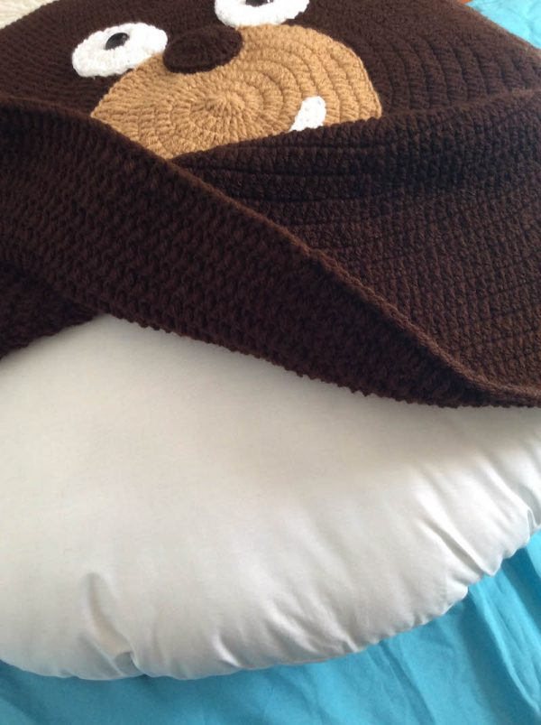 Free crochet pattern: Kodiak Bear Pillow Pal by Underground Crafter - inserting pillow form into almost finished piece