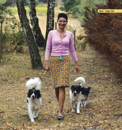 Crochet Blocks by Agnieszka Strycharska (with excerpted patterns for Motif 2 and Skirt) via Underground Crafter | Woman wearing granny square skirt walking outdoors with dogs