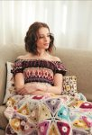 Granny Squares & Shapes by Susan Pinner - book review with Triangle Lap Blanket pattern excerpt on Underground Crafter - Triangle Lap Blanket on model