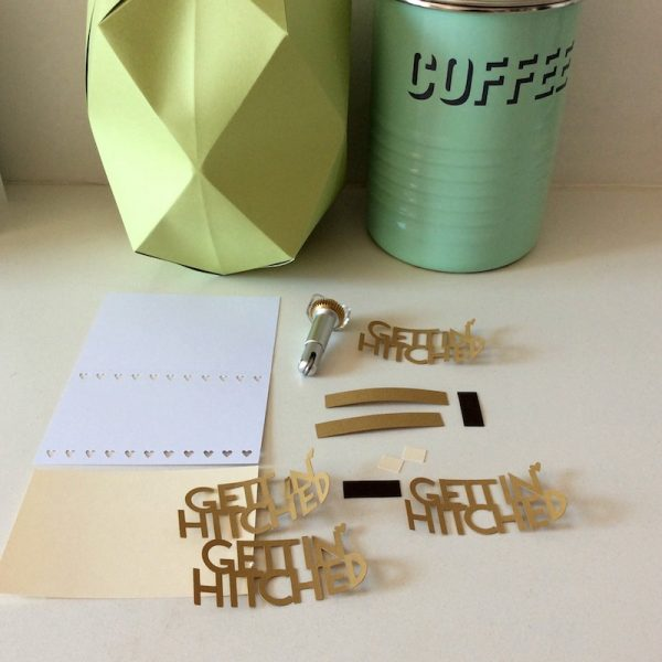 How To Make Picture Perfect Cards (and Other Folds) with the Cricut Maker Scoring Wheel by Underground Crafter - Gettin' Hitched card pieces with Paper Pineapple Vase in background