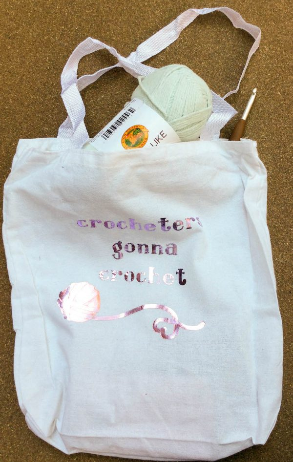 Make a Crocheters Gonna Crochet Iron-On Project Bag with Cricut by Underground Crafter - project bag with yarn and hook