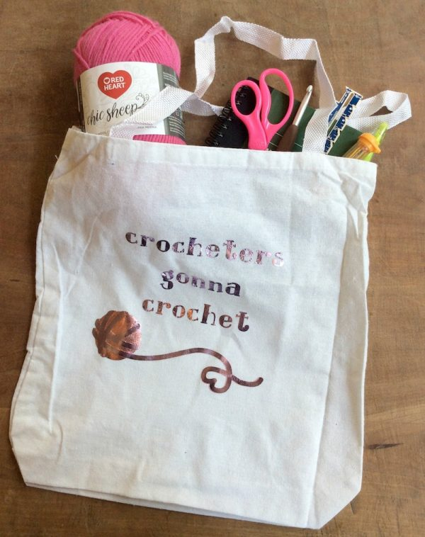 Crocheters Gonna Crochet project bag tutorial by Underground Crafter - on wood background