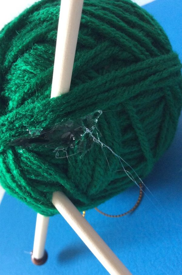 How To Make a Handmade Yarn with Knitting Needles Ornament with Hot Glue - tutorial by Underground Crafter - glued yarn tail after wrap