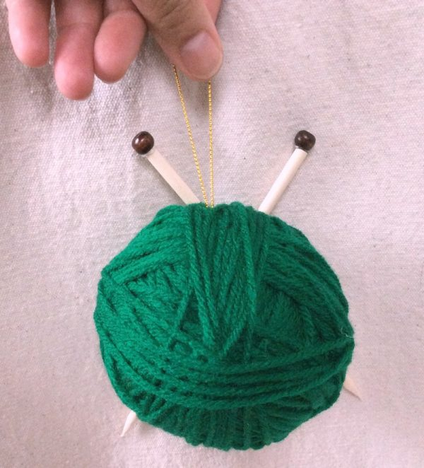 How To Make a Handmade Yarn with Knitting Needles Ornament with Hot Glue - tutorial by Underground Crafter - finished project in hand