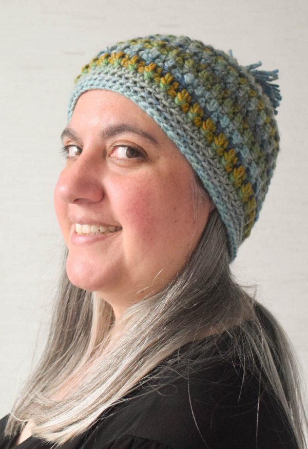 Arruga Stitch Hat, free crochet pattern in Red Heart Colorscape yarn by Underground Crafter | on Marie looking at camera