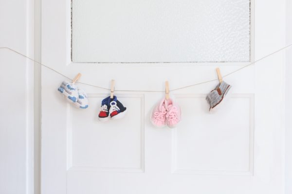 Free knitting pattern: Basketball Shoes booties by Helga Spitz (excerpted with permission from Classic Kicks for Little Feet: 16 Knitted Shoe Styles for Baby's First Year) via Underground Crafter | booties garland