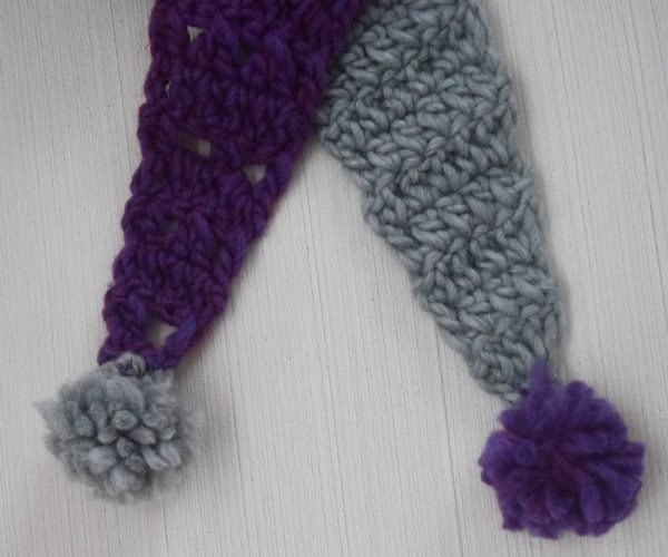 Free crochet pattern: Split Screen Pom Pom Scarf in Patons Alpaca Blend yarn by Underground Crafter - two ends with pom poms close up