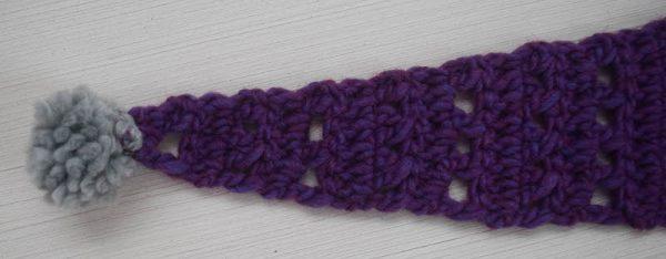 Free crochet pattern: Split Screen Pom Pom Scarf in Patons Alpaca Blend yarn by Underground Crafter - pom pom on end of scarf