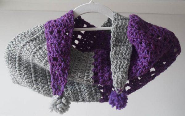 Free crochet pattern: Split Screen Pom Pom Scarf in Patons Alpaca Blend yarn by Underground Crafter - scarf on hanger