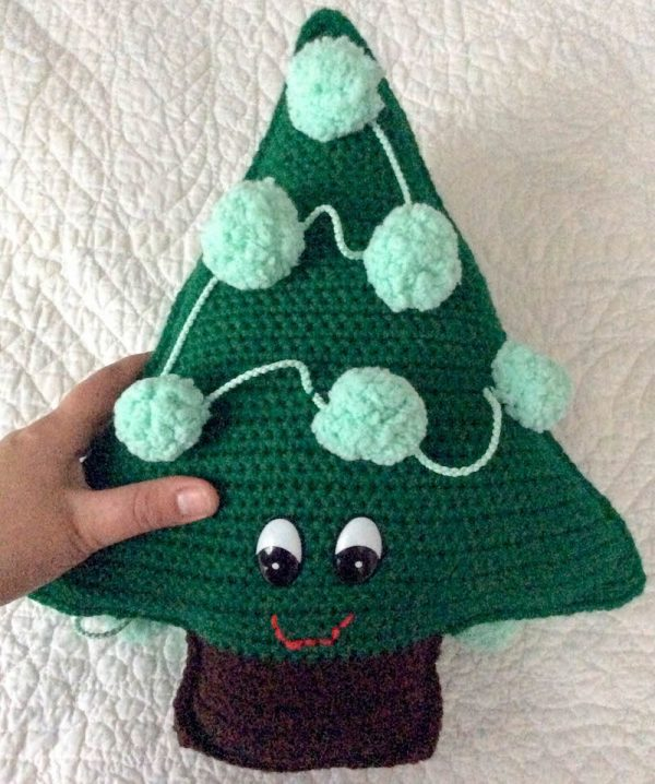 Chipper the Christmas Tree, free crochet pattern in Red Heart Super Saver and Pomp-a-Doodle yarns with Fairfield Poly-Fil stuffing by Underground Crafter | hand holding crocheted Christmas tree