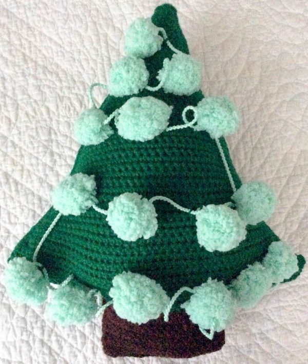 Chipper the Christmas Tree, free crochet pattern in Red Heart Super Saver and Pomp-a-Doodle yarns with Fairfield Poly-Fil stuffing by Underground Crafter | flat lay of crocheted Christmas tree (back with pom pom tinsel)